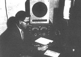 Yale Radio Club president James Douglas ('55),operates W1YU in the basement of Hendrie Hall in this photograph published in the Yale Daily News on 9/30/53.
